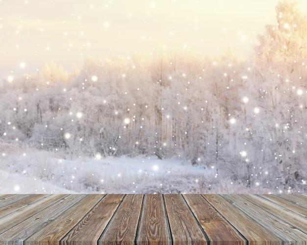 Haut de la table en bois vide sur fond d'hiver floue.