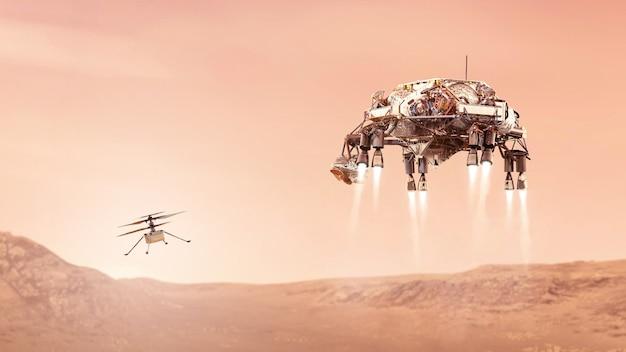 Hélicoptère d'ingéniosité et rover mars atterrissant sur les éléments de la planète rouge de cette image fournie par l'illustration de la nasa d