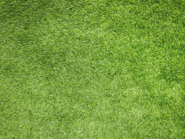 Herbe artificielle verte. texture de fond de pose de gazon artificiel.