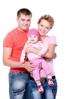 Heureuse jeune famille avec beau bébé sur