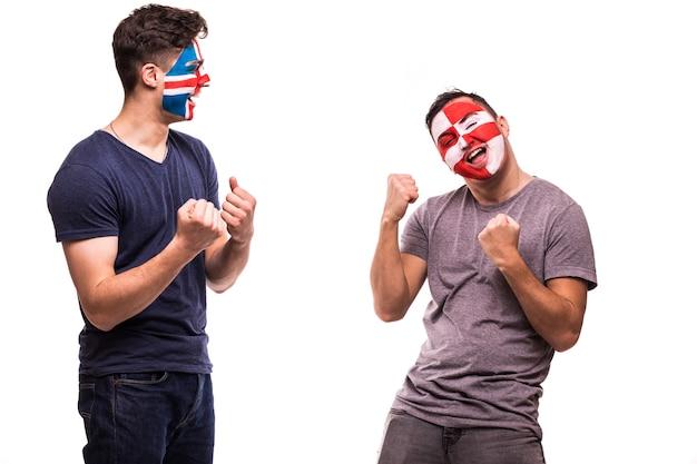 Heureux fan de football de croatie célébrer la victoire sur fan de football contrarié de l'islande avec visage peint isolé sur fond blanc