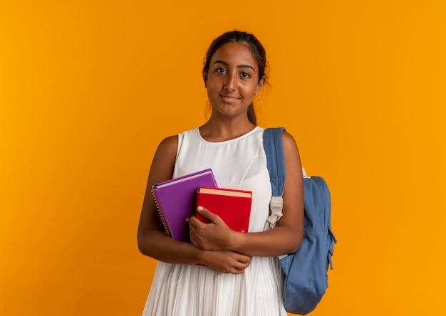 Heureux, jeune écolière, porter, sac à dos, tenue, livres