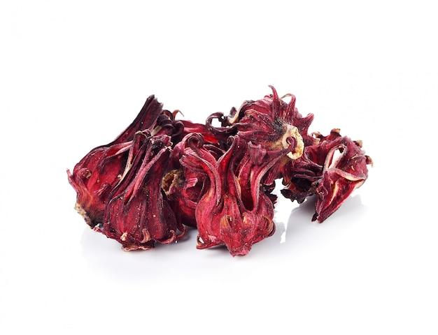 Hibiscus séché sabdariffa ou fruits roselle sur blanc.