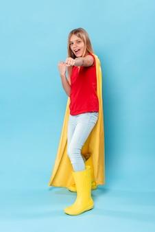 High angle young girl with hero costume