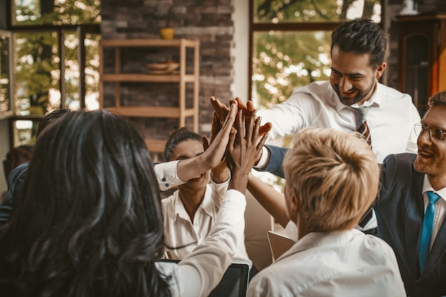 High five gesture from business people team