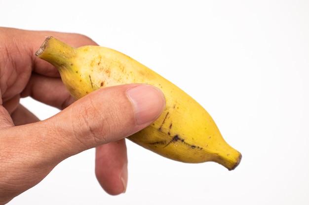 Holding banane isolé sur fond blanc