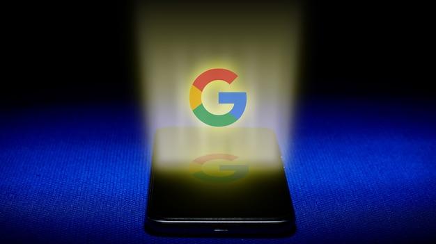Hologramme du logo google. image du logo google hologramme sur fond bleu.