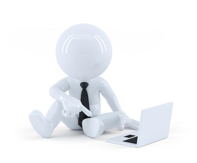 Homme d'affaires assis et utilisant un ordinateur portable.