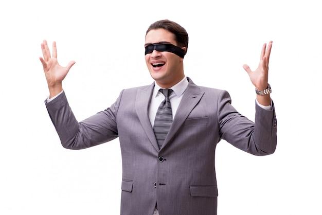 Homme d'affaires aux yeux bandés isolé