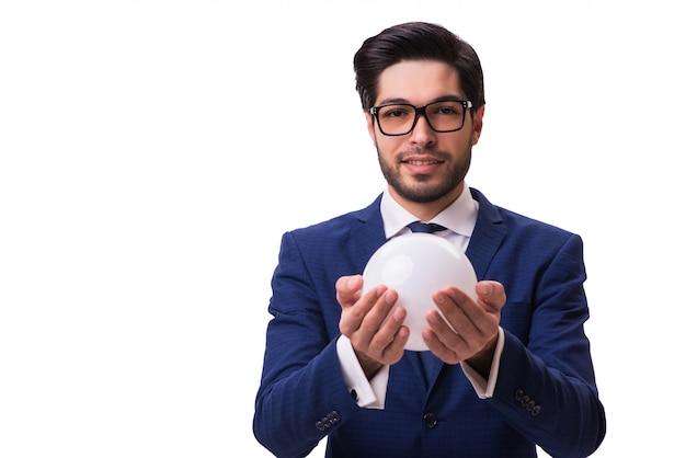 Homme d'affaires avec boule de cristal isolée
