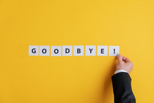Homme affaires, confection, au revoir, signe