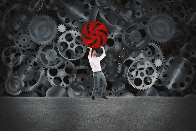Homme d'affaires construit un système d'entreprise en tant que mécanisme d'engrenages et met l'engrenage manquant