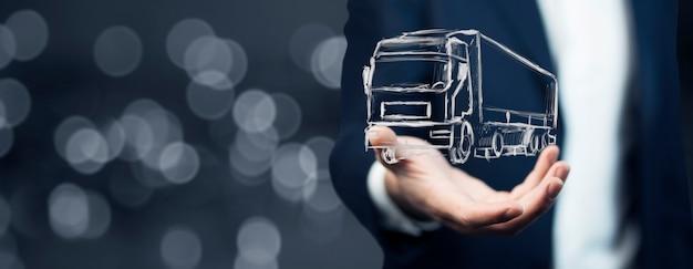 Homme d'affaires dessiner le transport de camion