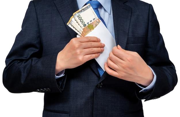 Homme d'affaires détenant la monnaie coréenne en main.