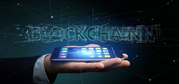 Homme d'affaires détenant un titre de blockchain isolé