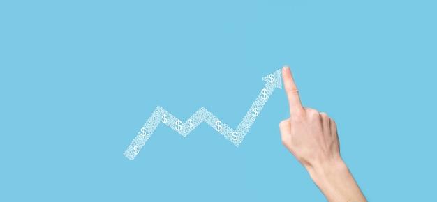 L'homme d'affaires détient des données de vente et un graphique de croissance économique. planification et stratégie d'entreprise.