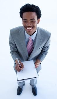Homme d'affaires, écrire des notes dans un cahier