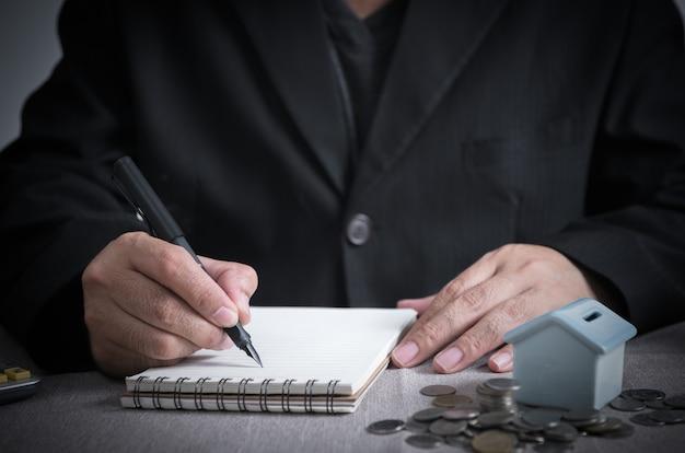 Homme affaires, écrire, revenus