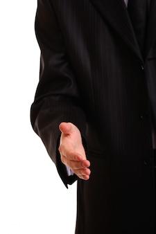 Un homme d'affaires avec une main ouverte prêt à sceller un accord