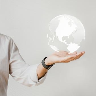 Homme d'affaires avec le monde dans sa main
