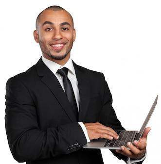 Homme d'affaires noir avec ordinateur portable