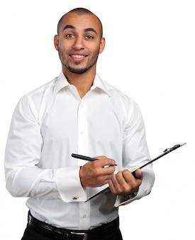 Homme d'affaires noir avec presse-papiers