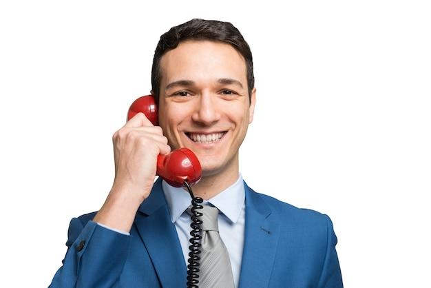 Homme d'affaires, parler sur un téléphone vintage