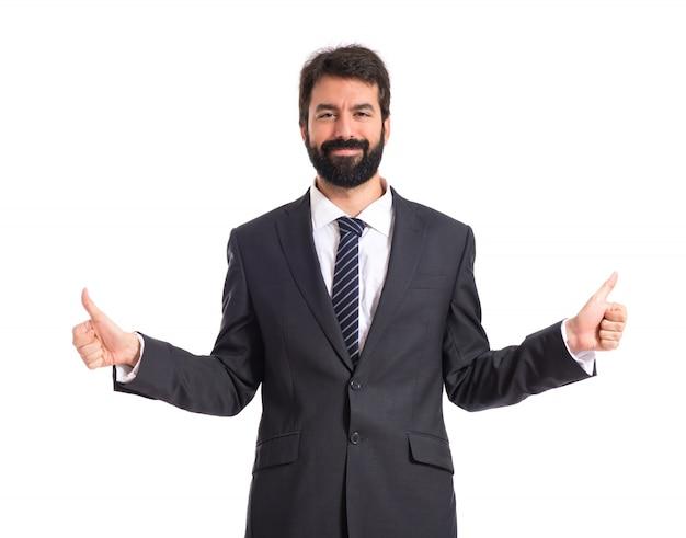 Homme d'affaires avec le pouce vers le haut sur fond blanc
