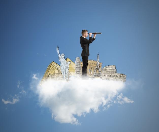 Homme d & # 39; affaires rêve et recherche de nouvelles destinations