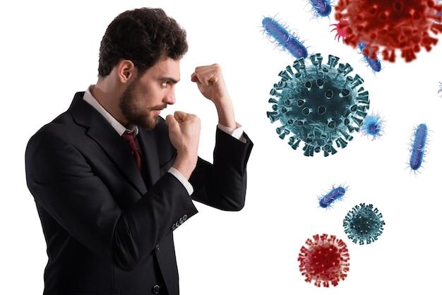 L'homme d'affaires se bat comme un boxeur. concept d'attaque de virus et de bactéries