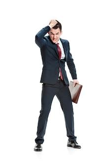 Homme d & # 39; affaires se tirant du film en colère sur blanc