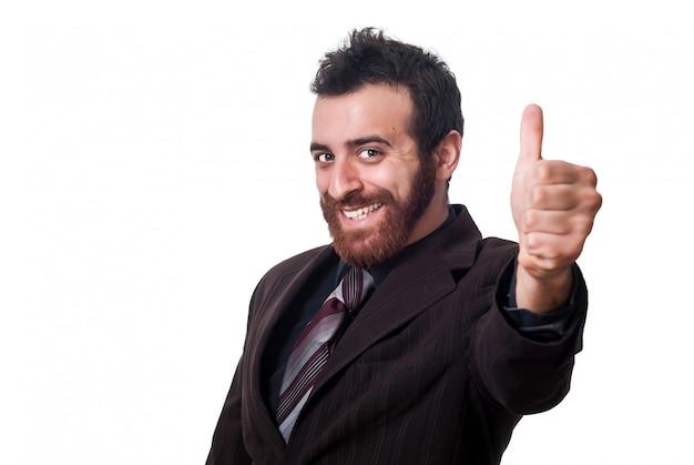 Homme d'affaires souriant avec le pouce vers le haut