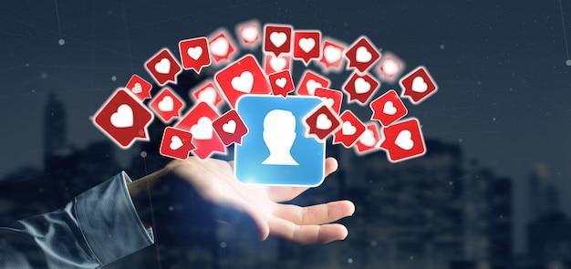 Homme d'affaires tenant comme une notification sur un contact sur un média social
