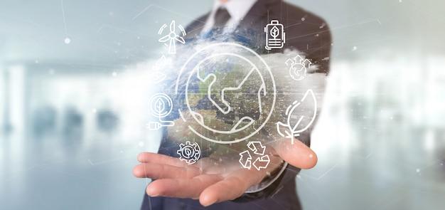 Homme d'affaires tenant un globe terrestre entourant des icônes de l'écologie et de la connexion