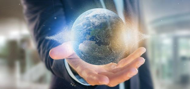 Homme d'affaires tenant un globe terrestre de particules