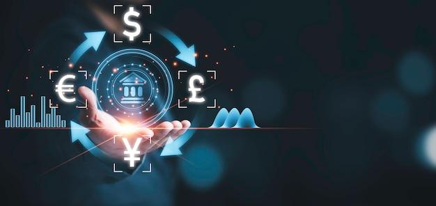 Homme d'affaires tenant une icône bancaire avec une devise telle que le dollar yuan livre et l'euro, le change de devises et le concept de forex.