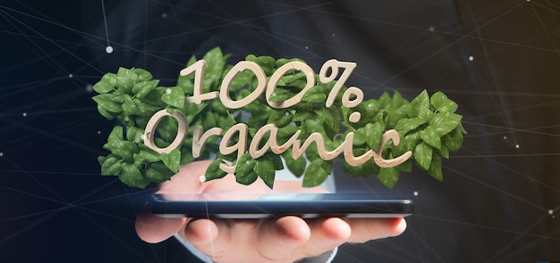 Homme d'affaires tenant un logo en bois 100% organique avec des feuilles autour