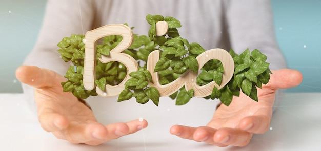 Homme d'affaires tenant un logo en bois bio avec des feuilles autour