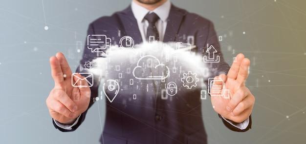 Homme d'affaires tenant un nuage d'icône multimédia rendu 3d
