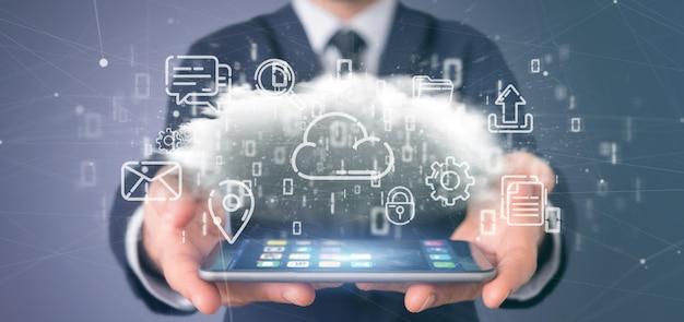 Homme d'affaires tenant un nuage d'icône multimédia