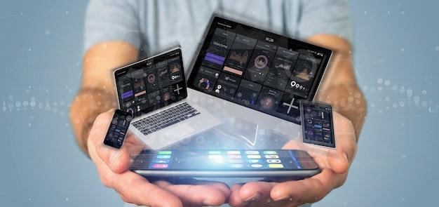 Homme d'affaires tenant des périphériques connectés à un réseau multimédia en nuage rendu 3d