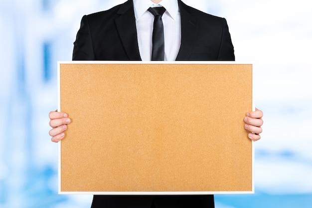 Homme affaires, tenue, vide, cadre photo