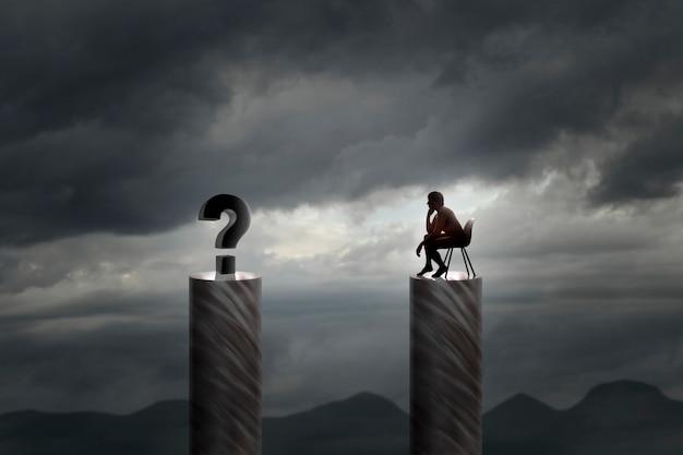 Homme assis face à un dilemme