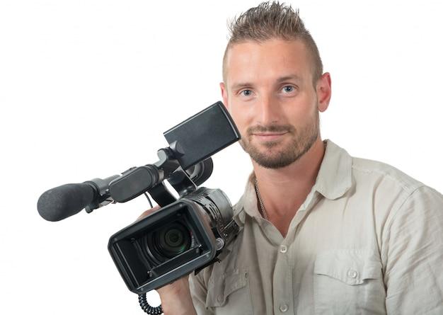 Homme avec caméscope professionnel isolé sur blanc