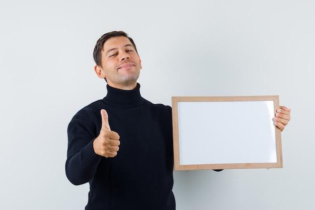 Un homme expressif pose dans le studio