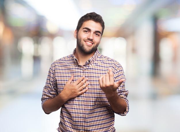 Homme avec un geste signe