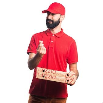 Homme de livraison de pizza faisant un geste d'argent