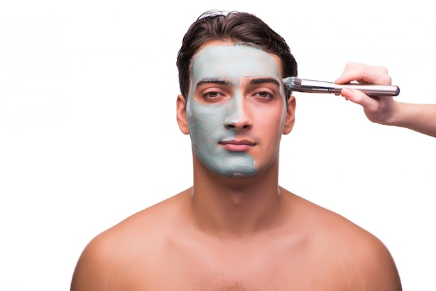 Homme avec masque appliqué sur blanc