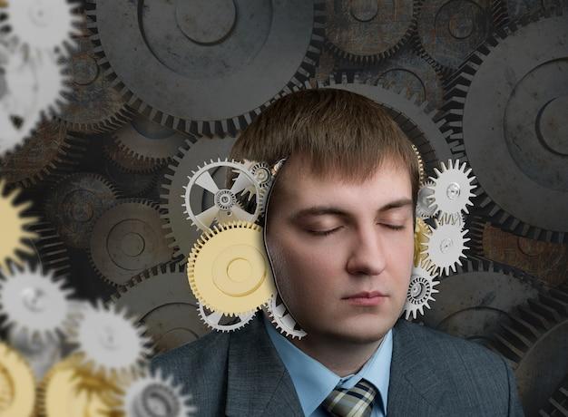 Homme avec mécanisme dans sa tête