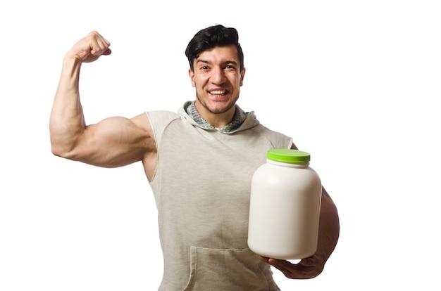 Homme musclé avec des pots de protéines sur blanc